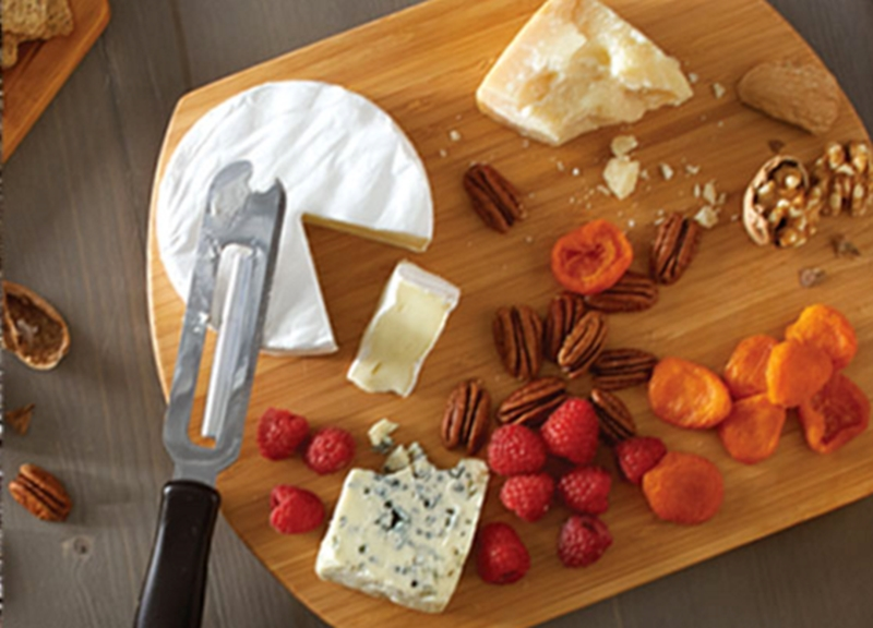 Cheese board with berries, nuts and cheese.